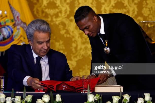 ExManchester United Ecuadorean footballer Luis Antonio Valencia gives Ecuadorean President Lenin Moreno a signed jersey of his former club after...