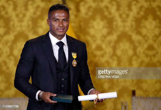 ExManchester United Ecuadorean footballer Luis Antonio Valencia poses after being decorated by Ecuadorean President Lenin Moreno with the National...
