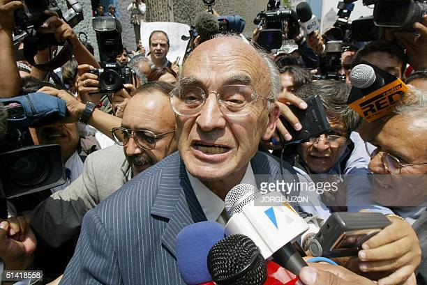Ex-Mexican president Luis Echeverria is surrounded by the press 09 July 2002 while coming out of the Special Office of the public prosecutor for...