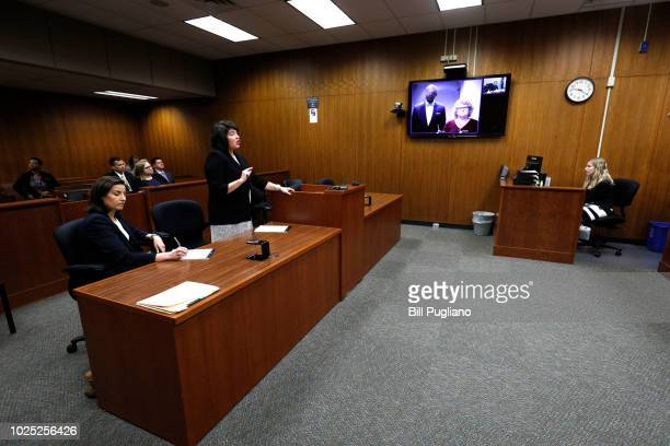 Ex-Michigan State University women's gymnastics coach Kathie Klages appears with her attorney Takura Nyamfukudza at a video arraignment before Judge...