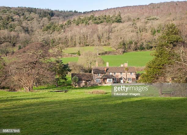 Exmoor farmhouse set amongst trees Brandish Street hamlet Selworthy Somerset England