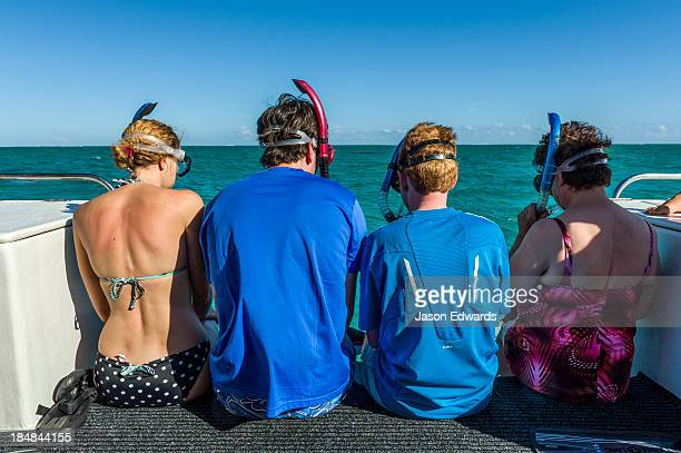 Tourists wait on the stern of a boat ready to dive with Whale Sharks.