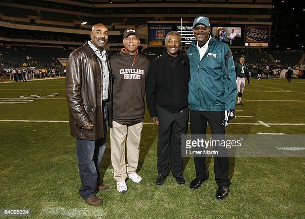 ExNFL wide receivers Mike Quick Wes Chandler Paul Warfield and Harold Carmichael stand on the field before a game between the Cleveland Browns and...