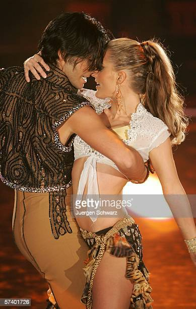 ExNo Angels singer Sandy Moelling and dancer Roberto Albanese perform at the dancing competition show on TV station RTL with German celebrities and...