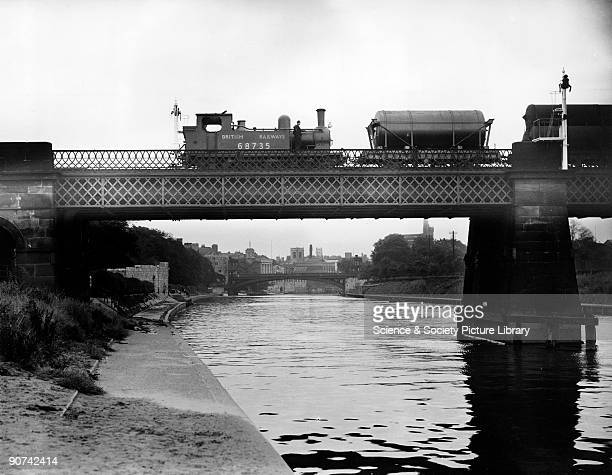 ExNorth Eastern Railways Class J72 060T locomotive No 68735 crosses Scarborough Bridge on the River Ouse York 15 August 1948 In contravention of the...