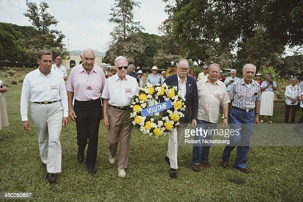ExOffice of Strategic Services agents carry a wreath at an OSS reunion in Thailand October 1987