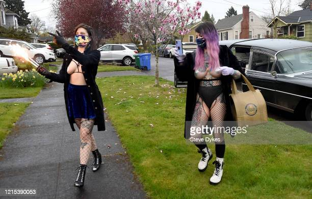 Exotic dancers Brodie Grody and Karma Jane arrive to deliver food on March 27 2020 in Portland Oregon A local Portland club The Lucky Devil started a...