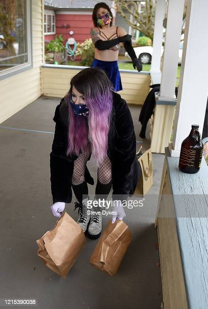 Exotic dancers Brodie Grody and Karma Jane deliver food on March 27 2020 in Portland Oregon A local Portland club The Lucky Devil started a food...