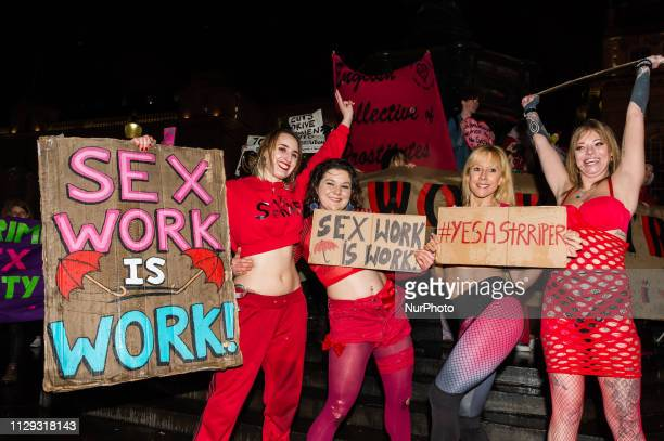 Exotic dancers perform in Piccadilly Circus in central London during a demonstration against discrimination of sex workers held on International...