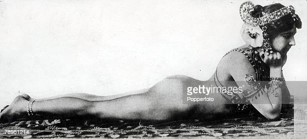 Exotic Dutch dancer Mata Hari who lived in France and was executed as a German spy in World War One pictured lying naked on her front and wearing an...