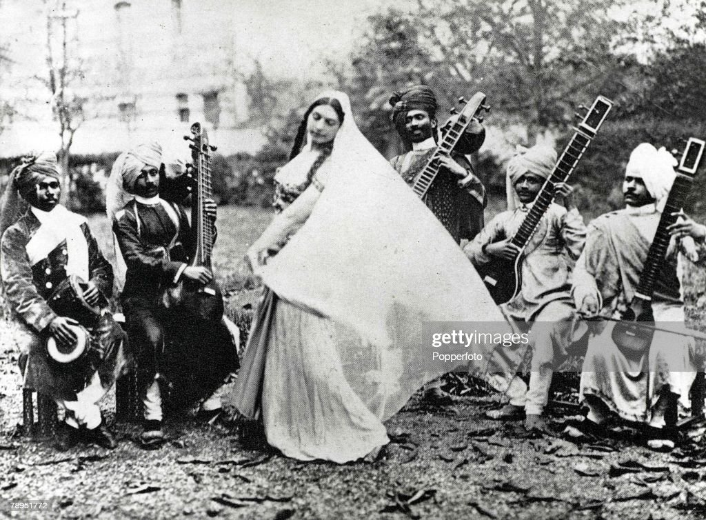 Exotic Dutch dancer Mata Hari who lived in France and was executed as a German spy in World War One, pictured in Paris practicing her Javanese Temple dance to music played by an Indian orchestra on sitars. : News Photo