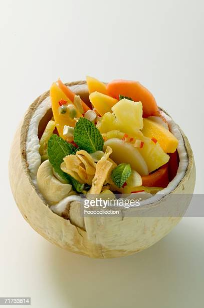 Exotic fruit salad in hollowed-out coconut