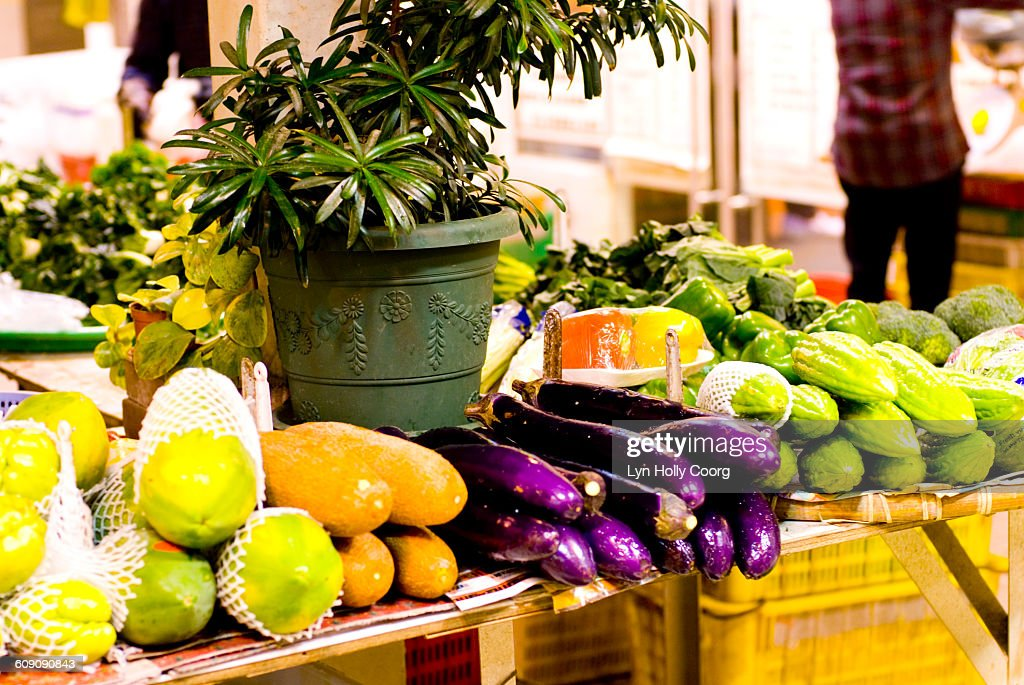 Exotic fruits fro sale on market stall : Stock Photo