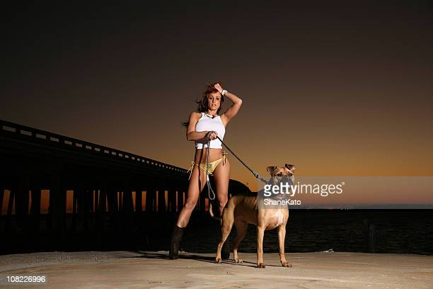 Exotic Sexy Bikini Girl Walking Dog at Sunset