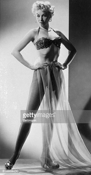 Exotic striptease artist Lili St Cyr has many glamorous charms as shown in these settings She is making a movie called Son of Sinbad