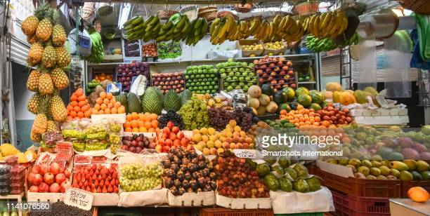 exotic tropical fruit in paloquemao market, bogota, colombia - cundinamarca stock pictures, royalty-free photos & images