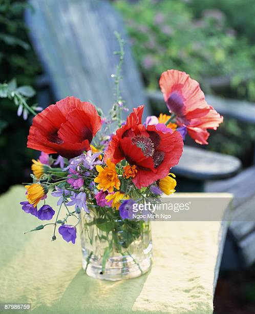 Exotic wildflowers in vase outdoors