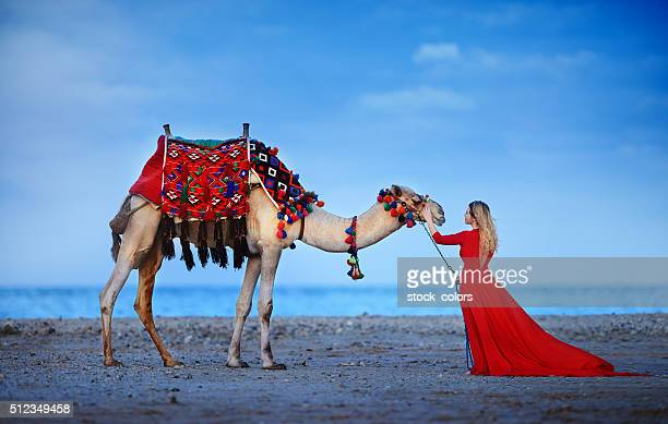 exotic woman near camel