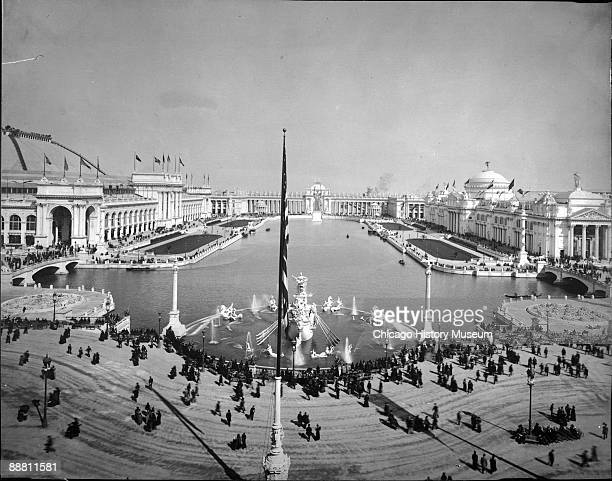 Expansive eastward view showing people strolling and visiting along the Basin and the Court of Honor at the Chicago World's Columbian Exposition or...