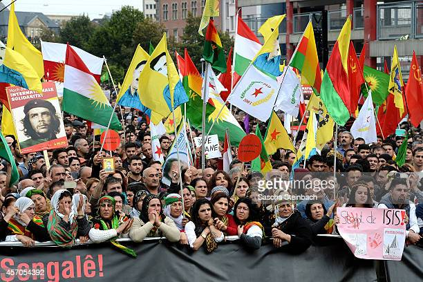 Expatriate Kurds bearing pictures of jailed Kurdish leader Abdullah Ocalan march to protest against the Islamic State and for support of the besieged...