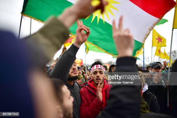 Expatriate Kurds shout slogans against Turkish President Recep Tayyip Erdogan and the war against the town of Afrin as they participate in...
