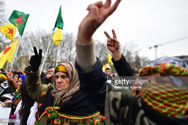 Expatriate Kurds shout slogans against Turkish President Recep Tayyip Erdogan as they participate in celebrations marking the Kurdish new year or...