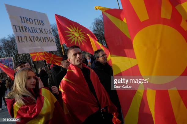 Expatriate Macedonians hold Macedonian flags and a sign that reads Against the tyranical platform in reference to the Tirana Platform during a...