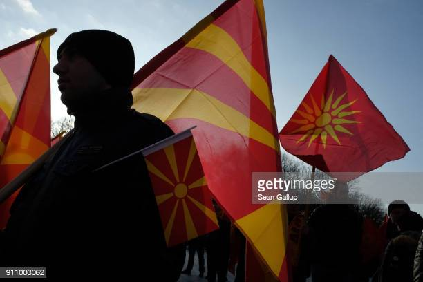 Expatriate Macedonians hold Macedonian flags during a protest rally under the title For a Common Macedonia on January 27 2018 in Berlin Germany The...