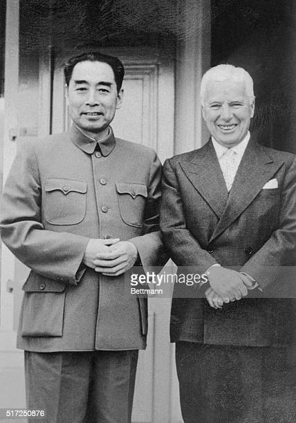 Expatriate movie comedian Charlie Chaplin and Communist Chinese premier Chou EnLai stand affably together at a party Chou hosted for some fifty...