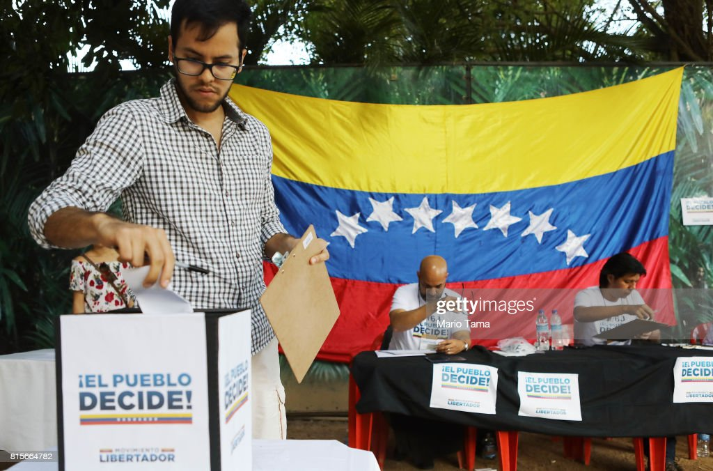 Expatriate Venezuelan Kristian Torres casts his ballot during an unofficial referendum, or plebiscite, held by Venezuela's opposition against Venezuela's President Nicolas Maduro's government on July 16, 2017 in Rio de Janeiro, Brazil. Voting was conducted across 2,000 polling centers in Venezuela and in more than 80 countries around the world amidst a severe crisis in Venezuela.