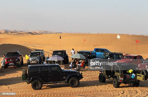 Expatriates set up their picnic spot during an offroad trip in the desert of Swaihan east of the United Arab Emirates on December 19 2014 Scores of...