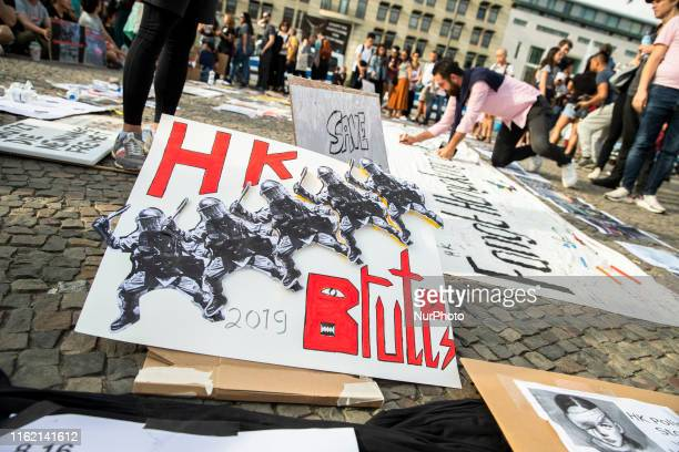 Expats and berliners attend a demonstration to support the protests in Hong Kong and against police violence in front of Brandenburg Gate in Berlin...