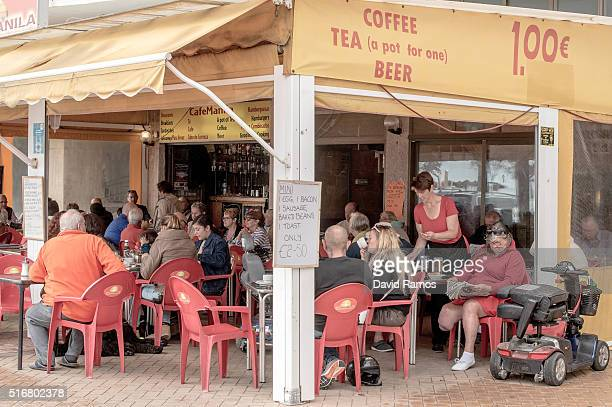 Expats and tourists have breakfast at a bar on March 19 2016 in Fuengirola Spain Spain is Europe's top destination for British expats with the...