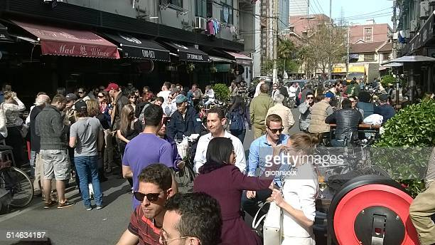 expats crowd in yongkang road, shanghai - expatriate stock pictures, royalty-free photos & images