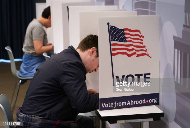 S expats fill out their ballots in US Democratic primary elections at a polling station hosted by Democrats Abroad on March 08 2020 in Berlin Germany...