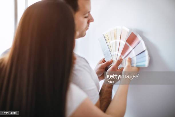 Expecting Couple choosing color for their baby's room