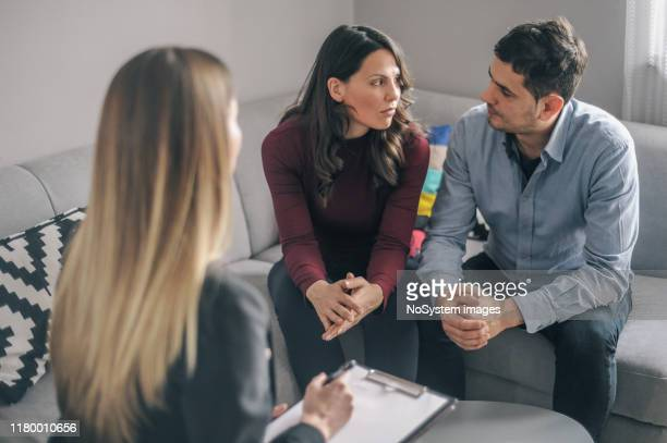 expecting couple on home counselling meeting - crisis stock pictures, royalty-free photos & images