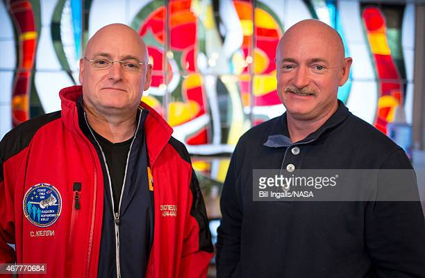 Expedition 43 NASA Astronaut Scott Kelly, left, and his identical twin brother Mark Kelly, pose for a photograph Thursday, March 26, 2015 at the...