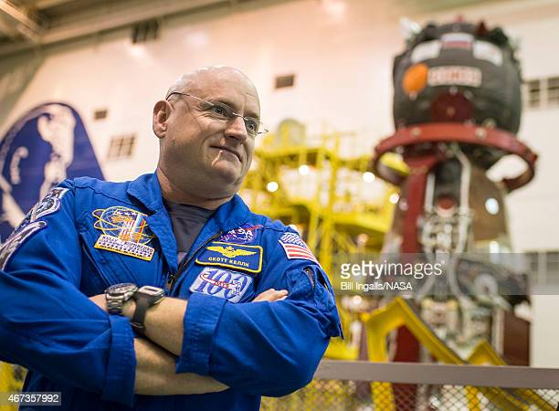 Expedition 43 NASA Astronaut Scott Kelly waits to climb the scaffolding to access the Soyuz TMA16M spacecraft for his final check with fellow crew...
