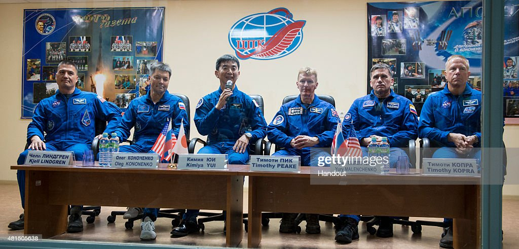 Expedition 44 prime crew members, Flight Engineer Kjell Lindgren of NASA, far left; Soyuz Commander Oleg Kononenko of the Russian Federal Space Agency (Roscosmos), second left; and Flight Engineer Kimiya Yui, center, of the Japan Aerospace Exploration Agency (JAXA), are seen with Expedition 44 back up crew members, Flight Engineer Timothy Peake of ESA (European Space Agency), third right; Soyuz Commander Yuri Malenchenko of the Russian Federal Space Agency (Roscosmos), second right; and Flight Engineer Timothy Kopra of NASA, far right, during a press conference held at the Cosmonaut Hotel in Baikonur, Kazakhstan on Tuesday, July 21, 2015. The mission is set to launch July 23 from the Baikonur Cosmodrome.