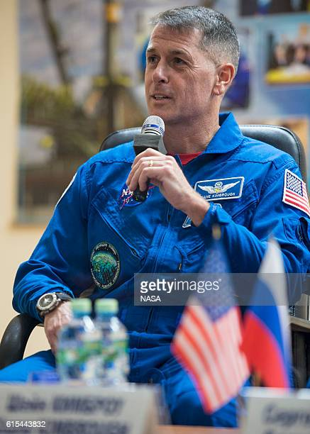 Expedition 49 flight engineer Shane Kimbrough answers a question during a crew press conference, while in quarantine behind glass, at the Cosmonaut...