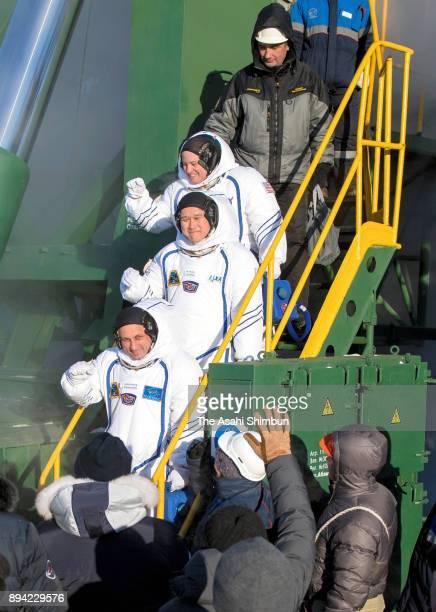 Expedition 54 flight engineer Scott Tingle of NASA top flight engineer Norishige Kanai of Japan Aerospace Exploration Agency middle and Soyuz...