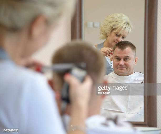 Expedition 57 Flight Engineer Alexey Ovchinin of Roscosmos gets his hair cut Tuesday Oct 9 2018 at the Cosmonaut Hotel in Baikonur Kazakhstan...