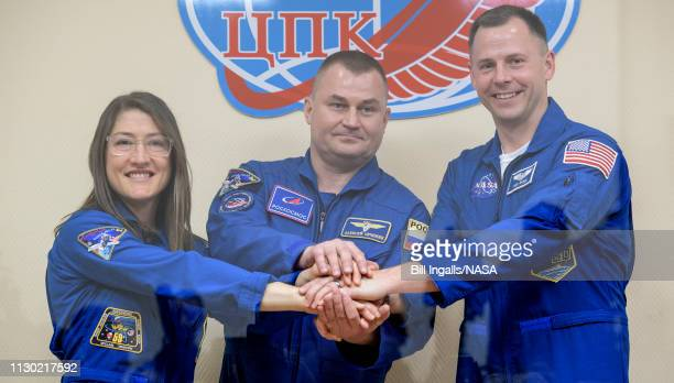 Expedition 59 prime crewmembers Christina Koch of NASA left Alexey Ovchinin of Roscosmos and Nick Hague of NASA right pose for a photograph at the...