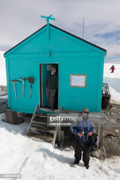 Expedition guides Damoy Hut nesting gentoo penguins Wiencke Island Antarctic Peninsula Antarctica