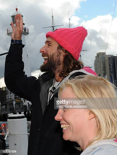 Expedition leader David de Rothschild the youngest heir to Britain's Rothschild family banking fortune and skipper Jo Royle acknowledge the applause...