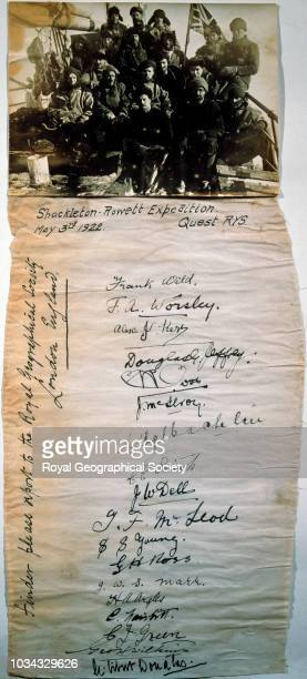 Expedition members and their signatures Attached to the photograph is a piece of paper measuring 6 x 11 inches with the signatures of the crew on it...