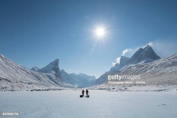 Expedition members cross the frozen landscape while towing sleds during a ski traverse of Akshayuk Pass in Auyuittuq National Park on April 14 2017...