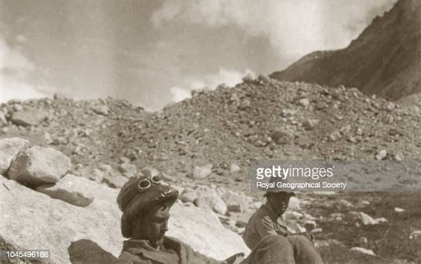 Expedition members resting George Mallory reading Tibet China Mount Everest Expedition 1921