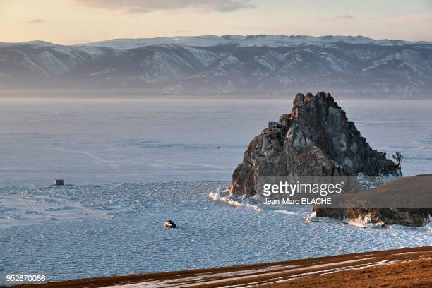 Expedition to Lake Baikal in Siberia Bakal Lake under ice in winter Rock of Shamans on Olkhon Island on March 7 2011